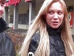 Blonde goes for risky outdoor blowjob