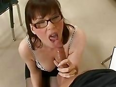 Brunette teacher with glasses sucks students hard prick in classroom