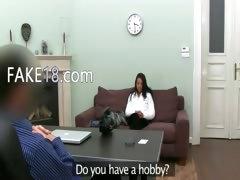 brunett girl teasing fake agent on sofa