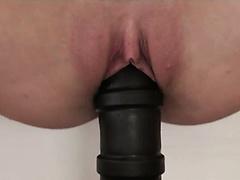 Shaved cunt and huge black dildo
