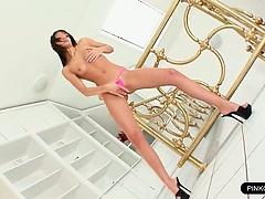 Bikini slut spreading to reveal pink pussy
