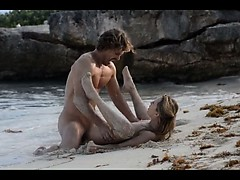 amazing art sex of horny couple on beach