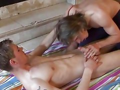 Nasty twinks doing blowjob in front of the fireplace