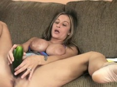 Busty cougar Leeanna Heart masturbates with a cucumber