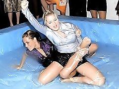 Girls wrestling in goo