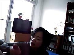 Mature Asian Strokes a Cock