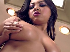 Asian fondles her amazing boobs