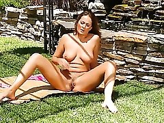 Big boobs hottie in the garden fingering her snatch
