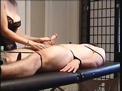 Handjob on the Jerktable with a huge Cumblast