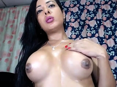 Busty latin tranny strokes her big cock