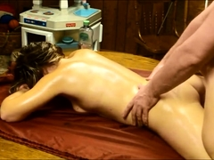 Amateur wife gets drilled from behind on the massage table
