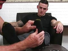 Young and slick guy Marco gets his feet licked and massaged