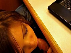 Lustful wife gives head under the table and gets her face