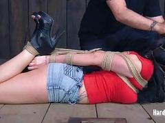Luxurious brunette wearing black boots is fucked in exciting bondage