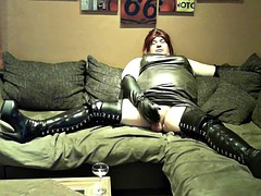 All dressed in leather and boots with heels while stroking it