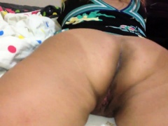 Amateur wife lies on her belly and exposes her sweet holes