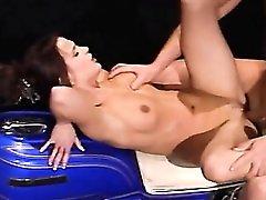 Slut smokes as a biker fucks her pussy