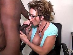 Deauxma is blowing a fat, ebony pecker in her office and then railing it like mischievous
