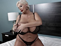 Slut with huge tits pleasuring herself on the bed