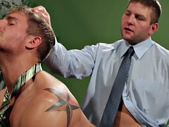 Gay hunk rides in the office on hard cock