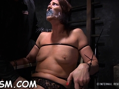Gal gets her neck restrained and knockers clamped