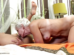 Old hairy granny licks and fucks young girl