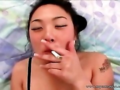 Nasty Asian slut smoking while sucking dick and in fishnet lingerie! 2