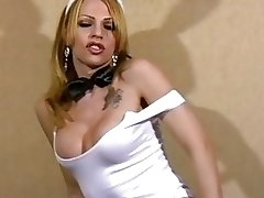 Blonde t-girl with big tits wears stockings while fapping