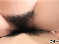 Asian honey rides big dildo with hairy cunt in office