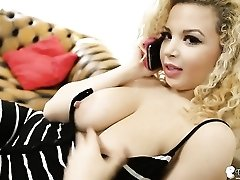 Beauty on the phone pulls out her big tits