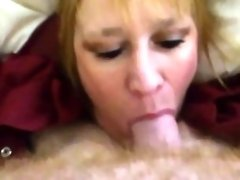 Amateur blonde cougar eating a hard shaft