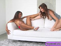 This ebony babe gets seduced by a mature busty mom into a lovely lesbian adventure