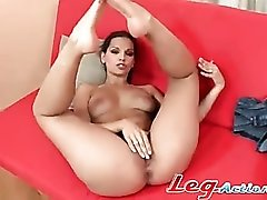 Eve Angel with legs up masturbates her pussy
