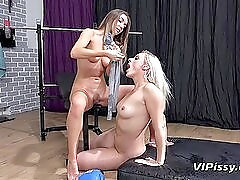 Workout girls have naughty fun peeing on each other