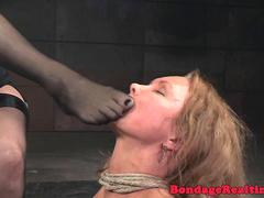 Fishnet blonde gets dominated in bondage by lezdom