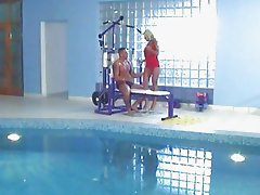 Tanned blonde slut gets drilled by muscled hunk in the gym