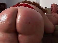 Chubby redhead milf with big tits sucks mature cock on her knees
