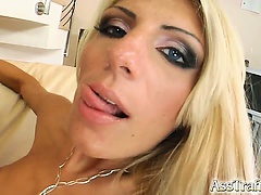This thin blonde gets her ass impaled by a couple of large cocks. They double penetrate her tight holes and then fill her mouth with a couple loads of